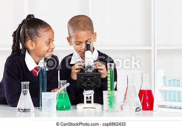 elementary school kids in lab - csp6862433