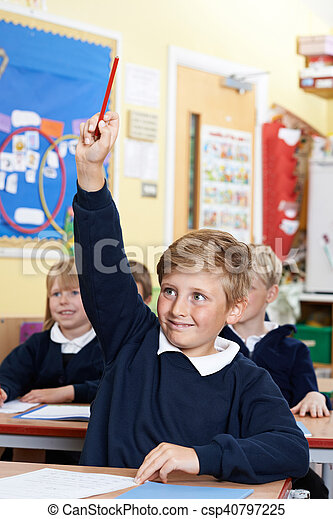 Elementary School Pupil Answering Question In Class - csp40797225