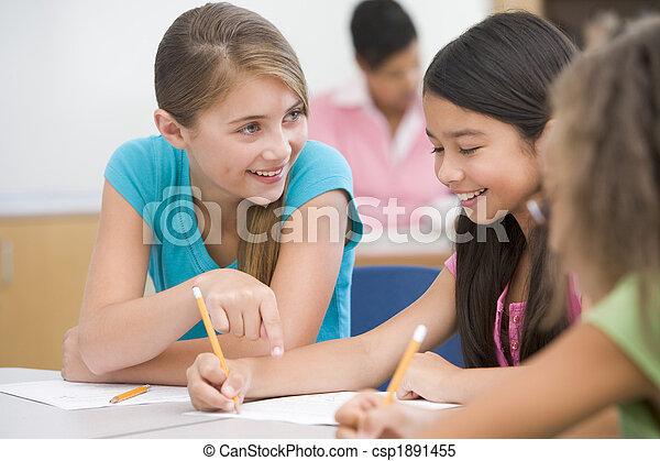 Elementary school pupils in classroom - csp1891455