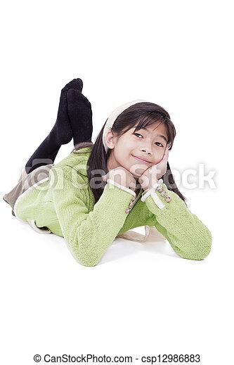 Eleven year old girl lying on floor relaxing - csp12986883