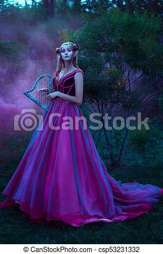 O sabor da esperança - Página 3 Elf-woman-in-violet-dress-stock-photos_csp53231332