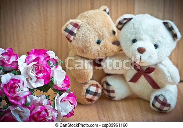 Embrace Bears in love, sit near bouquet rose - csp33961160