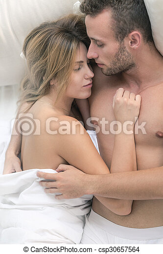 nude couple sleeping