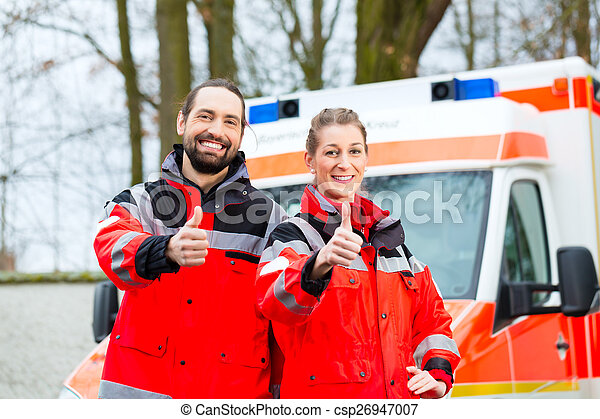 Emergency doctor in front of ambulance car - csp26947007