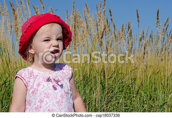 Emotional Little Girl with funny Face Expression  - csp18037336