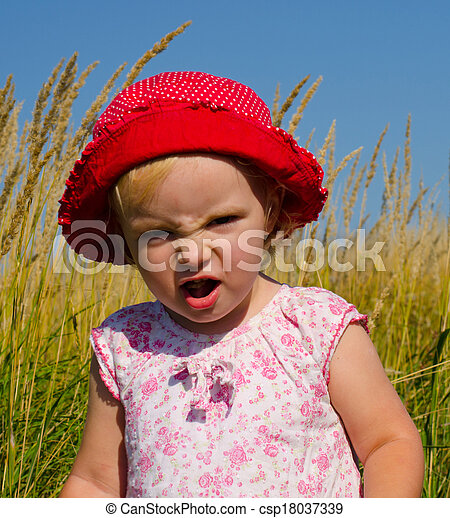 Emotional Little Girl with funny Face Expression  - csp18037339