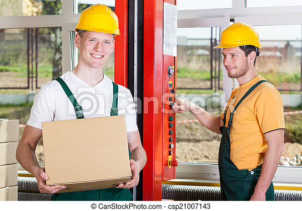 Employees working in big factory - csp21007143