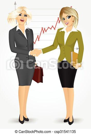 Dos rubias mujeres de negocios estrechando la mano - csp31541135