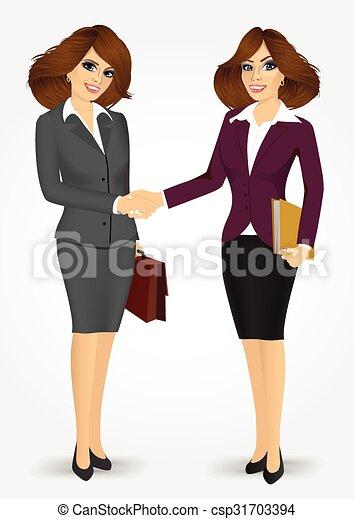 Dos mujeres de negocios estrechando la mano - csp31703394