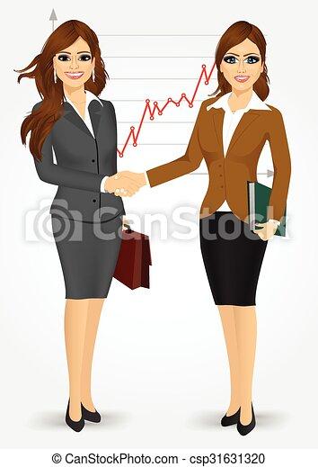 Dos mujeres de negocios estrechando la mano - csp31631320