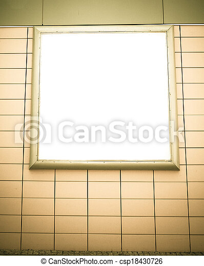 Empty blank square white advertising billboard on orange tiled wall - csp18430726