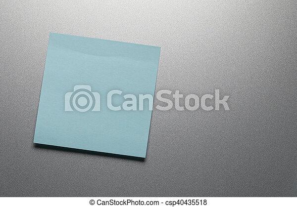 Empty blue paper sheet on refrigerator door. - csp40435518