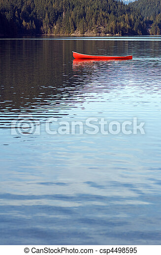Empty canoe on lake - csp4498595