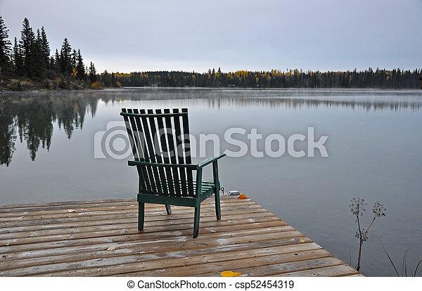 Empty chair on autumn morning - csp52454319