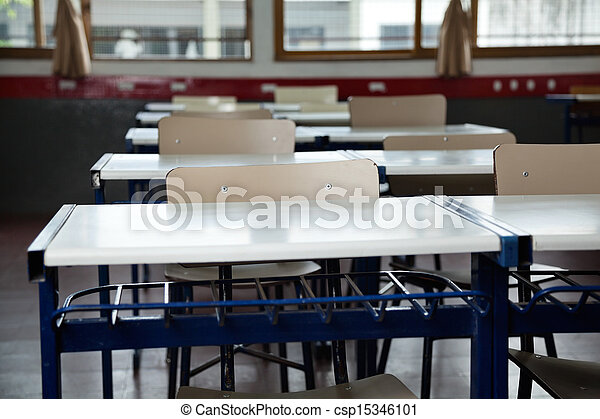 Empty Classroom With Chairs And Desks