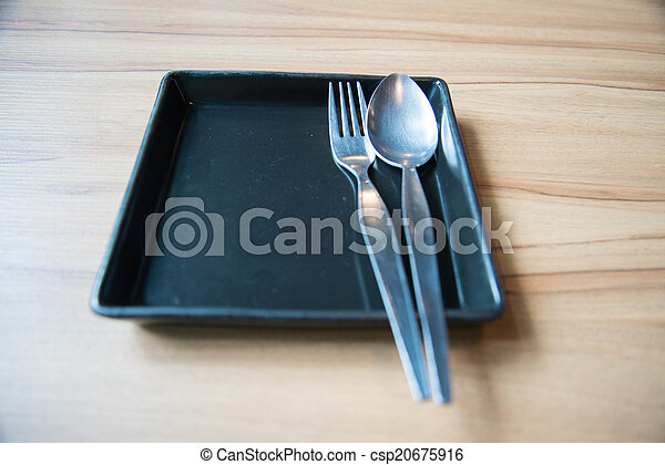 Empty dish and spoon fork - csp20675916