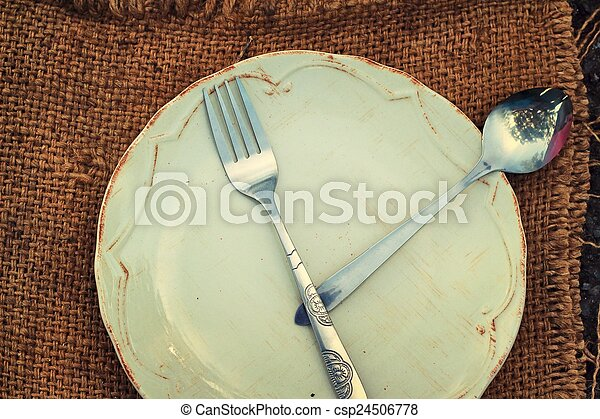 Empty dish and spoon fork. - csp24506778