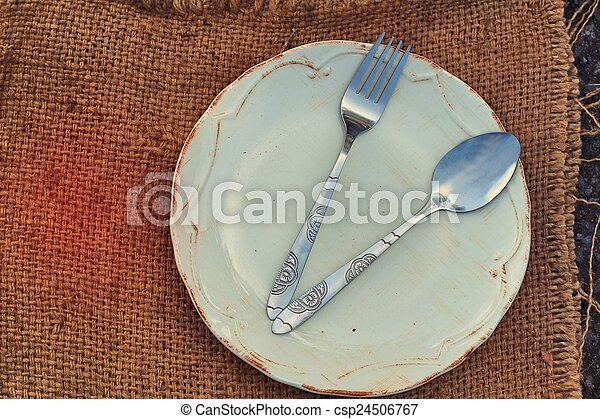 Empty dish and spoon fork. - csp24506767