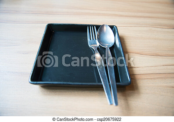 Empty dish and spoon fork - csp20675922