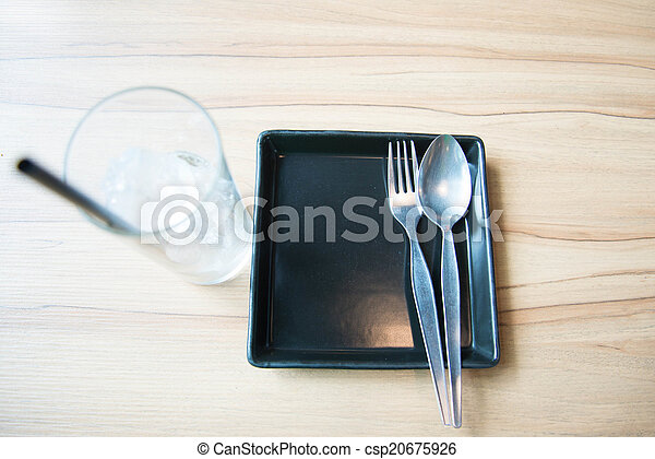 Empty dish and spoon fork - csp20675926
