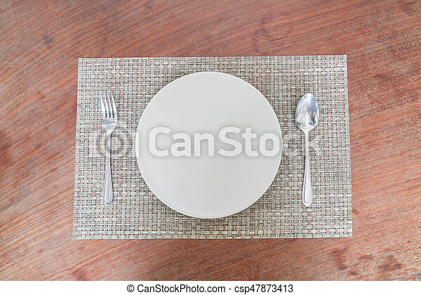 Empty dish spoon and fork - csp47873413