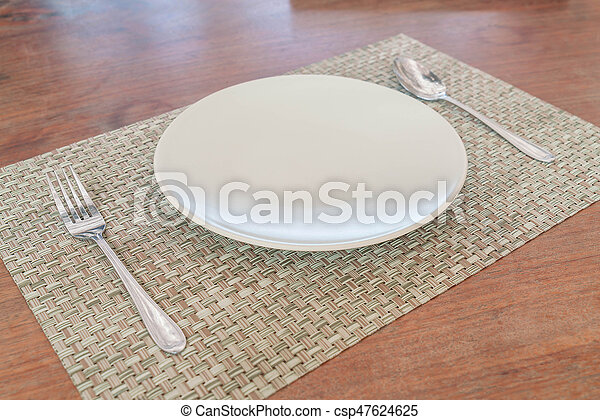 Empty dish spoon and fork - csp47624625