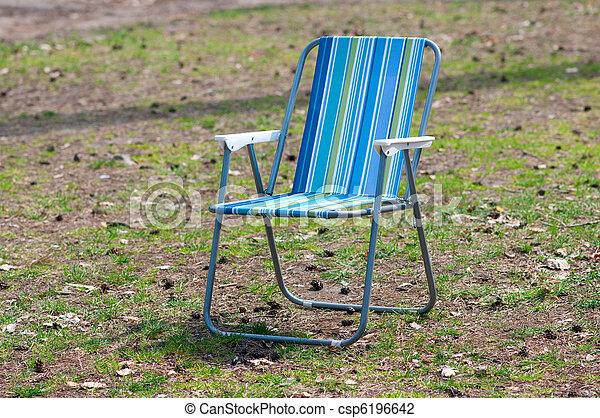 Empty garden chair on grass - csp6196642