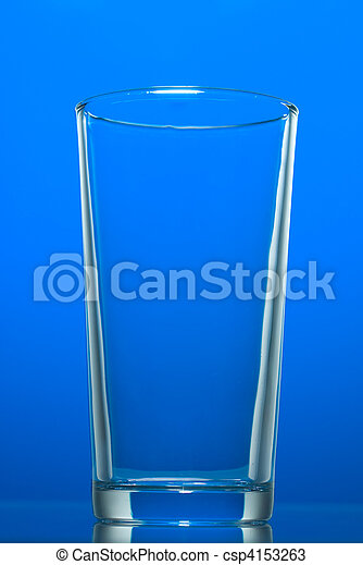 Empty glass isolated on blue - csp4153263