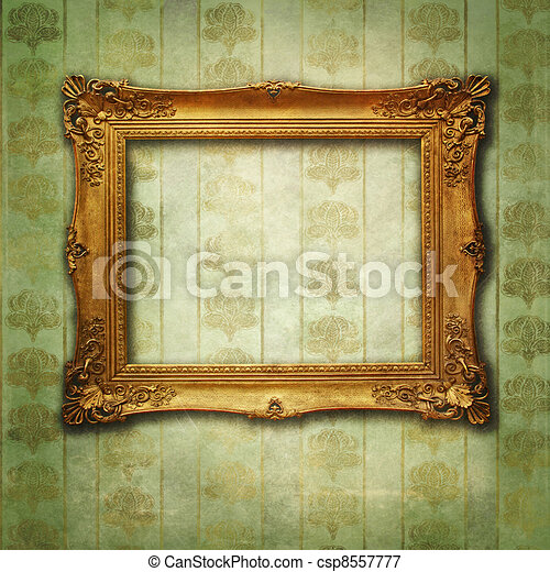 Empty golden frame on Victorian floral green-gold wallpaper - csp8557777