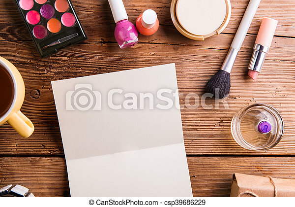 Empty greeting card laid on table. Make up products. - csp39686229