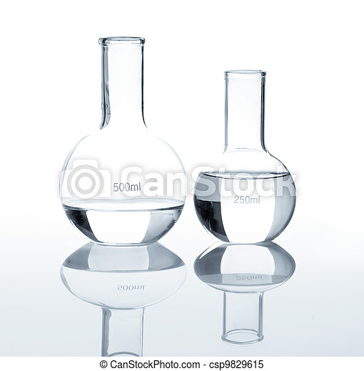 Empty laboratory flasks with a clear liquid - csp9829615