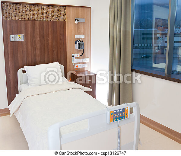 Empty modern hospital bed - csp13126747
