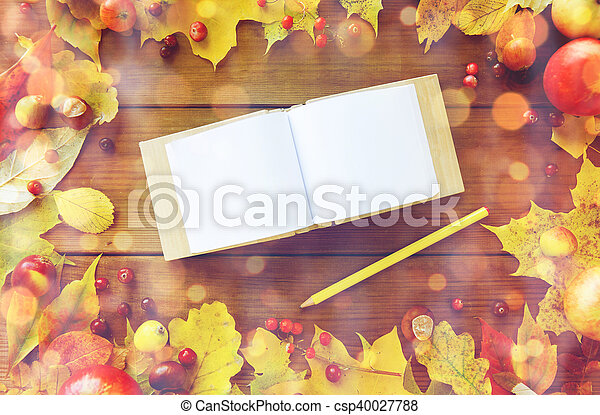 empty note book with pencil and autumn leaves - csp40027788