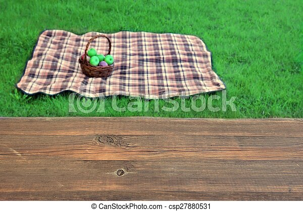 empty picnic table close up blanket with basket in the background