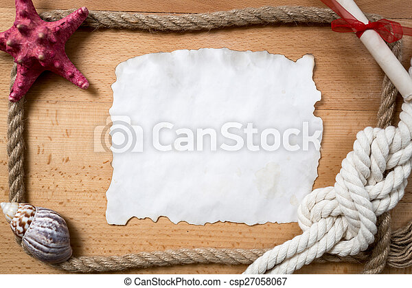 empty piece of paper with border of ropes, knots and seashells - csp27058067