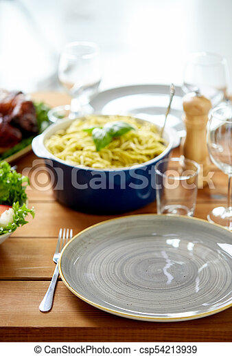 empty plate and fork on wooden table with food - csp54213939