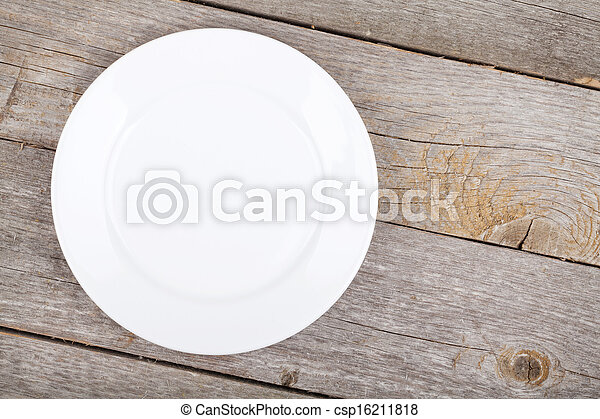 Empty plate on wood table - csp16211818