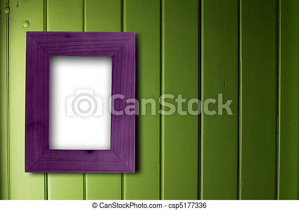 empty purple frame fixed on a green wooden wall, the color of the inner part of the frame is white - csp5177336