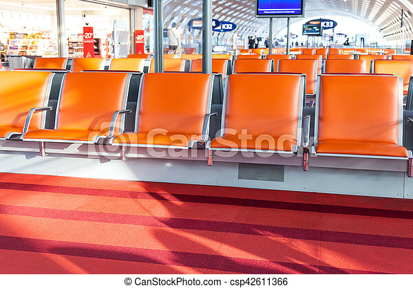 empty seat in departure hall of airport - csp42611366
