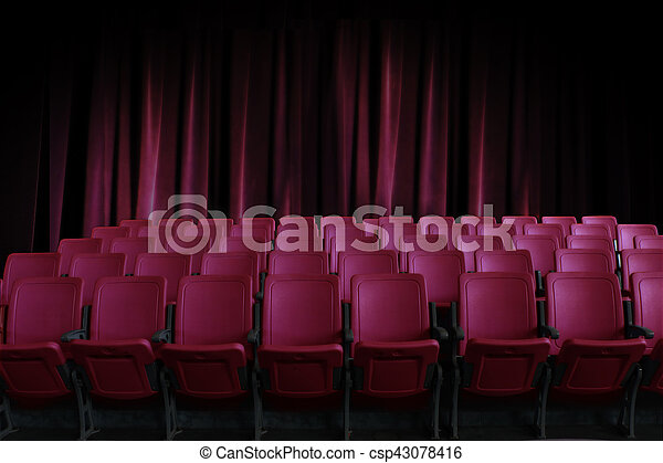 empty seats in the cinema with old red curtain background - csp43078416