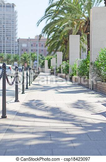 Empty sidewalk in the city center. - csp18423097