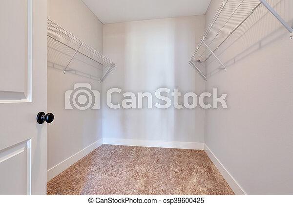 empty walk in closet. Unique Closet Empty Small Walkin Closet With Shelves And Carpet Floor  Csp39600425 In Walk Closet C