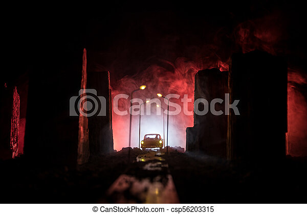Empty street of burnt up city, flames on the ground and blasts with smoke in the distance. Apocalyptic view of city downtown as disaster film poster concept. City destroyed by war. - csp56203315