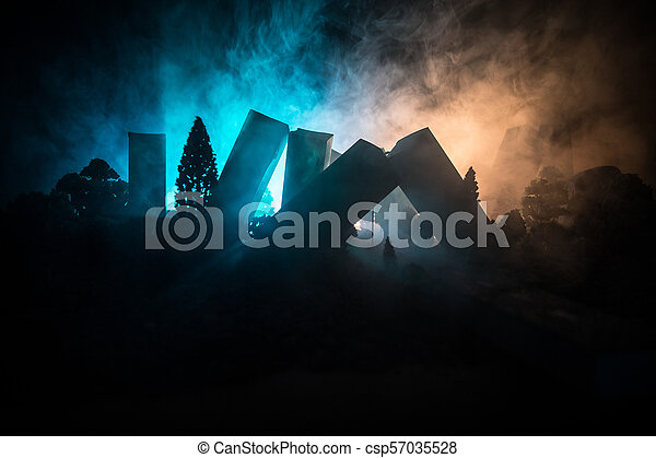 Empty street of burnt up city, flames on the ground and blasts with smoke in the distance. Apocalyptic view of city downtown as disaster film poster concept. Night scene. - csp57035528