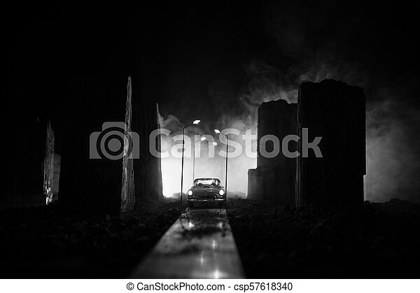 Empty street of burnt up city, flames on the ground and blasts with smoke in the distance. Apocalyptic view of city downtown as disaster film poster concept. City destroyed by war. - csp57618340