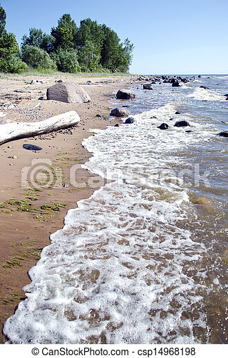 empty summer resort beach with stones and waves - csp14968198