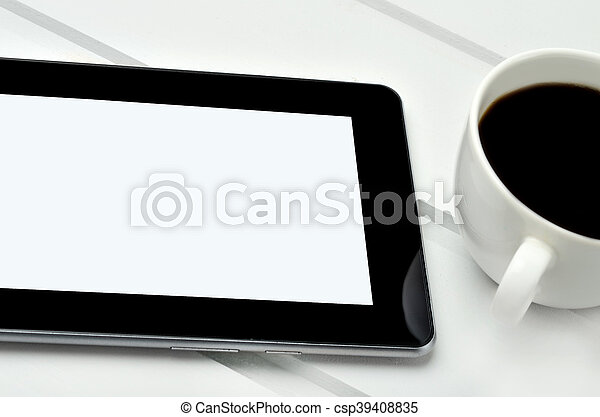 Empty tablet with coffee cup - csp39408835
