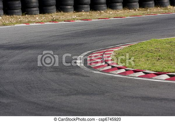Empty tarmac race track corner - csp6745920