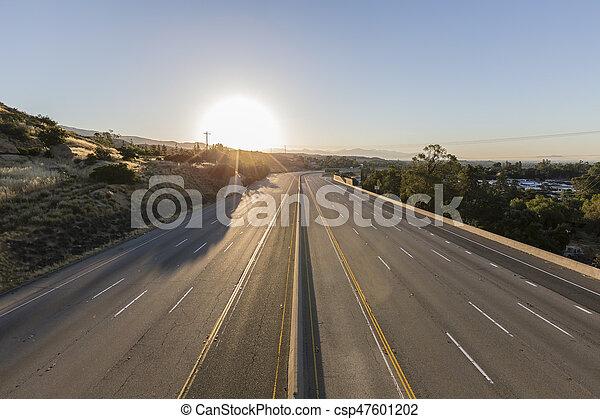 Empty Ten Lane Freeway Sunrise - csp47601202