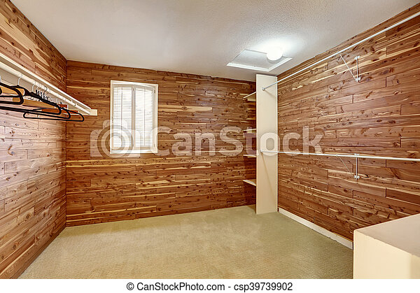 empty walk in closet small empty walkin closet with wooden walls and carpet floor csp39739902 northwest usa